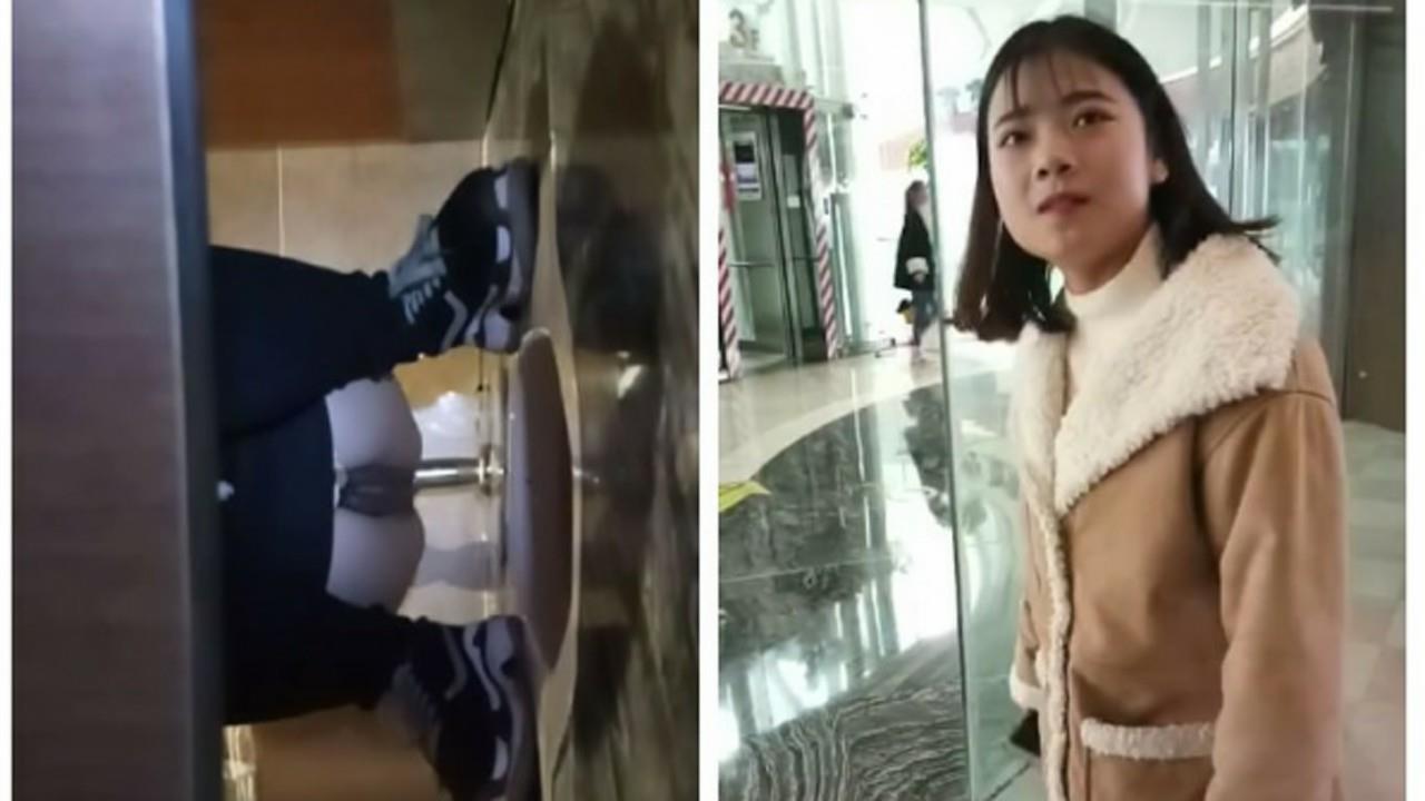 某站流出大胆牛人潜入某大厦女厕偷窥出来故意搭讪妹子拍脸